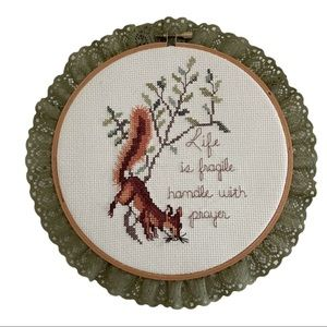 Vintage cross stitched wall art
